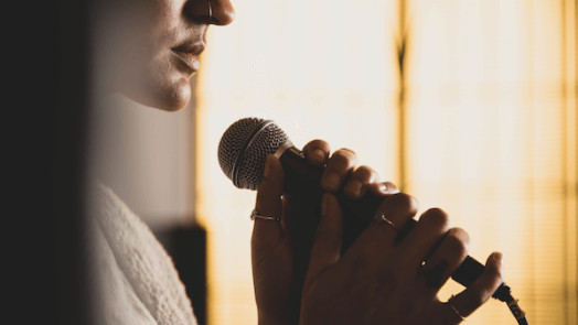 woman singing a worship song about trusting God in hard times