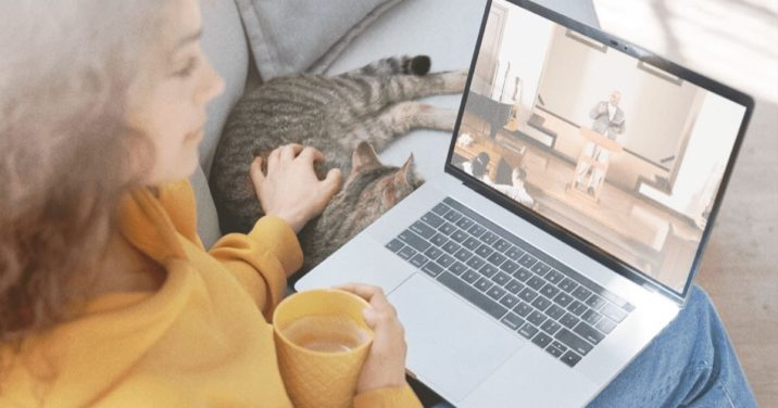 woman on couch watching church live streamed service