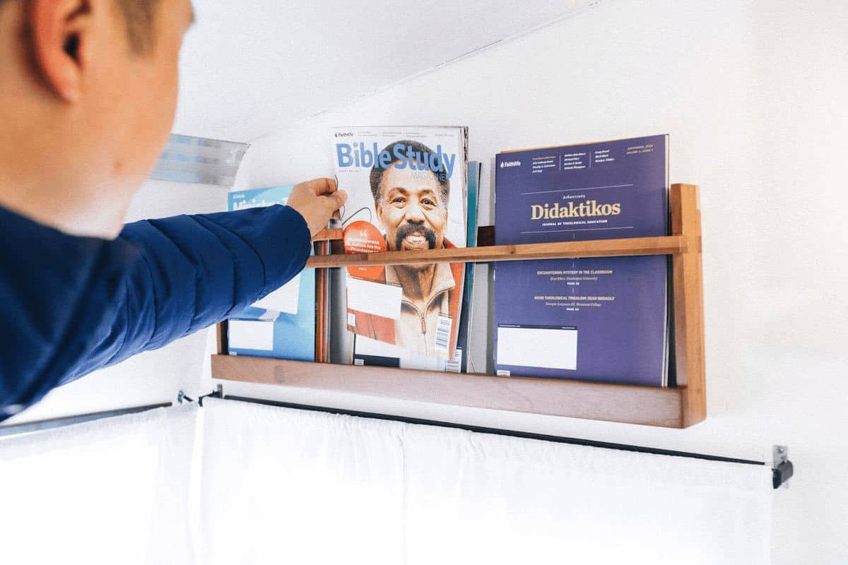 pastor getting a magazine to read in the Pastor Pod