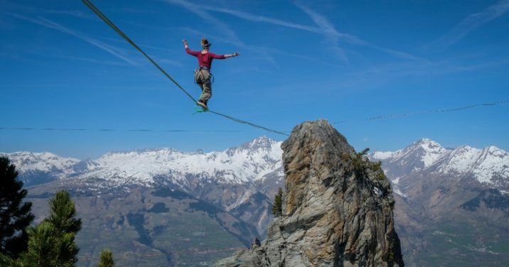 woman showing faith walking on a tightrope